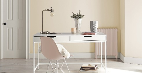 Chic office workspace with yellow walls, and white trim, white desk, inviting and friendly style.