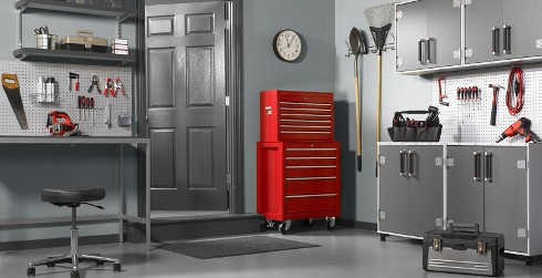 Garage workspace with gray walls and gray trim, red tool chest, versatile and comfortable style.