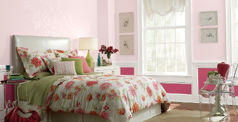 Youth room with pinks walls and white trim, white bed, casual style.