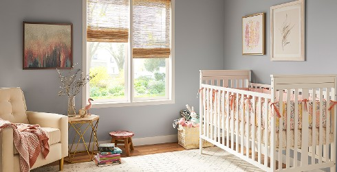 Youth room with gray walls and white trim, white crib, casual style.