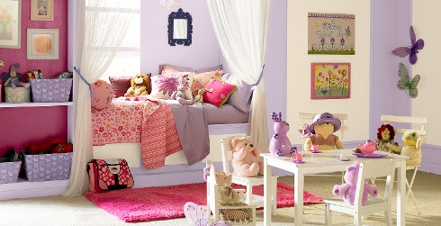 Classic styled youth room with light purple walls, white on the trim, and stuffed animal tea party.