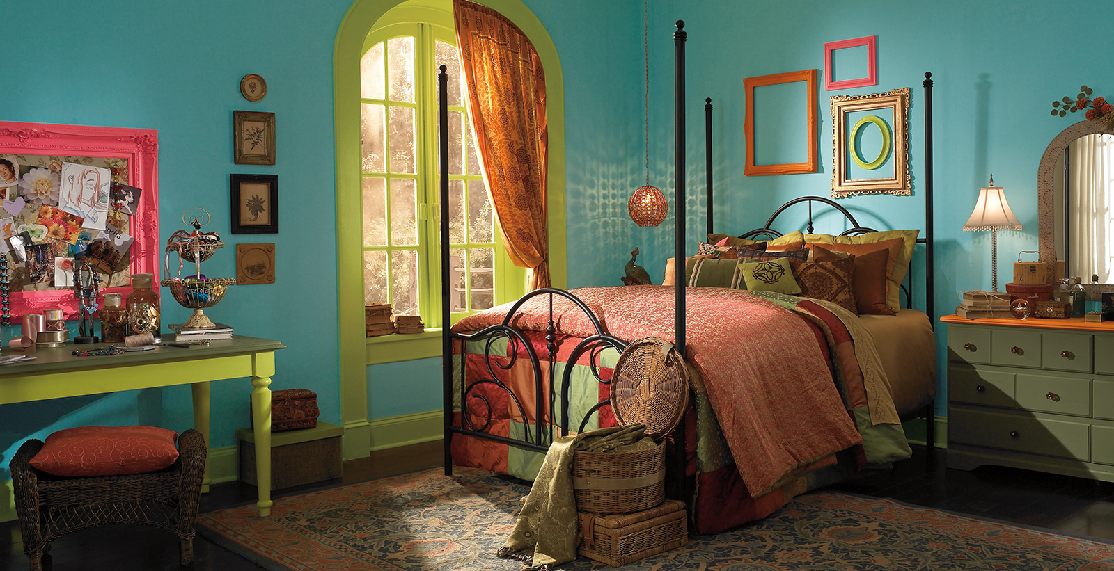 Eclectic styled youth room with blue walls, green trim, and bohemian styled bed.