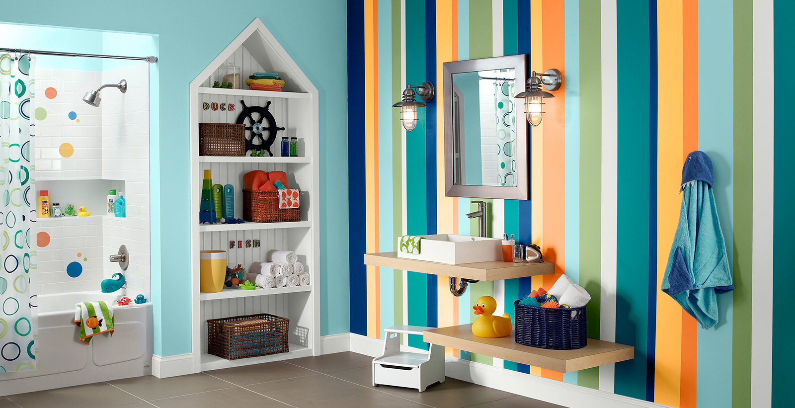 Eclectic styled youth bathroom with blue, yellow, orange and white striped wall, white trim, and coastal themed decoration.