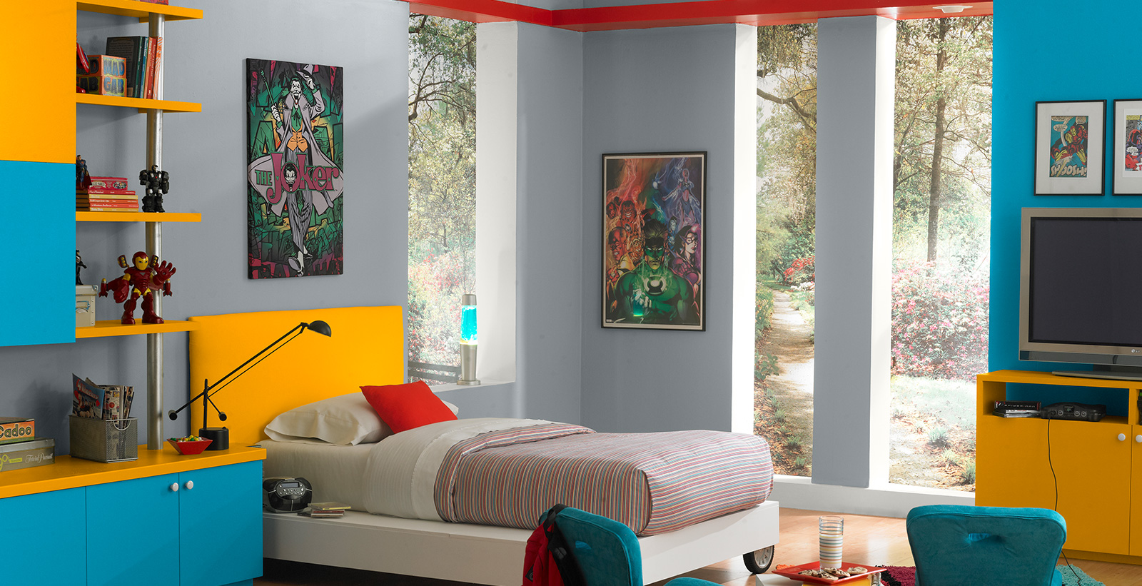 Modern styled youth room with gray walls, white on the trim, bright blue and yellow accents, and comic book artwork.
