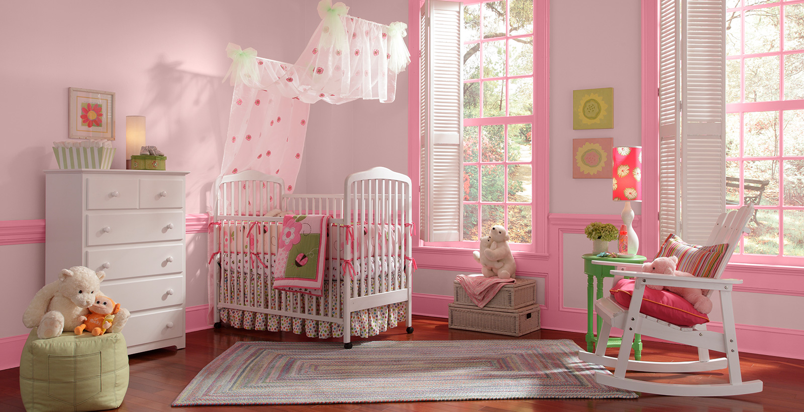 Youth room with red walls, pink trim, white nursery crib with white rocking chair.