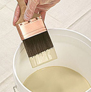 Dip brush into paint.