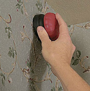 Use scoring tool to perforate wallpaper.