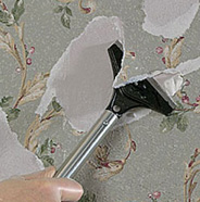 Use scraper to peel off wallpaper.