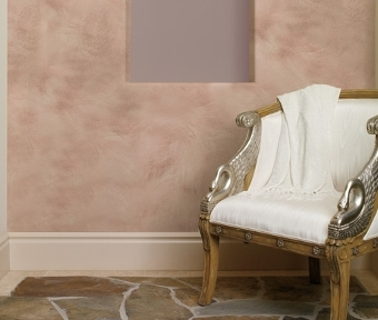 Classic chair in front of white, pink and color designed wall