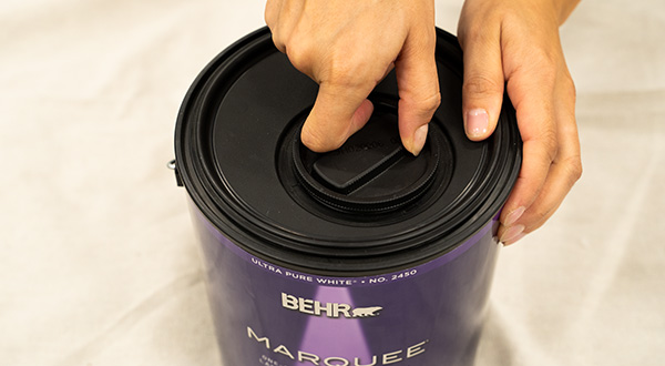Close-up of person twisting open the lid.
