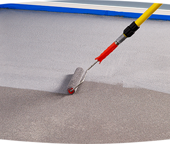 Applying granite grip to floor with roller