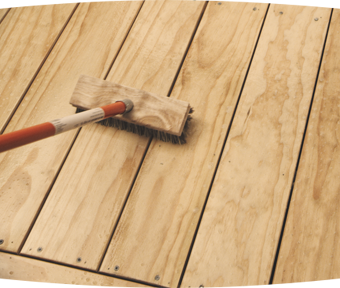 Prepping and sweeping a wood deck