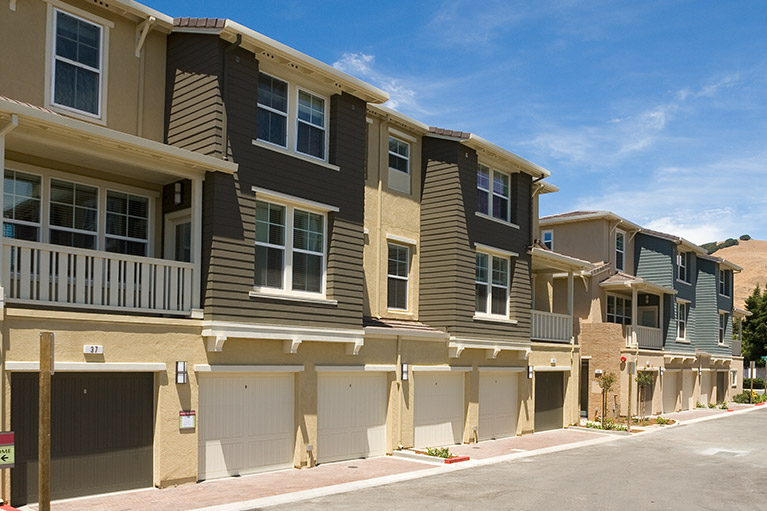 Small image of an exterior of a multi-family home properties next to each other.