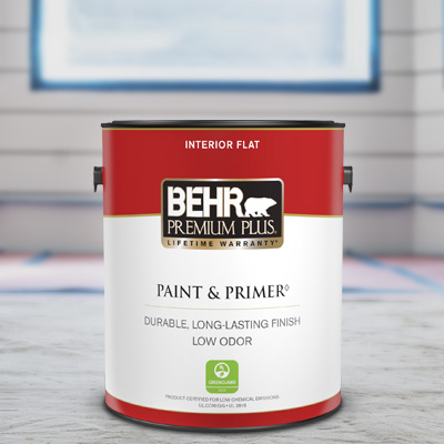 A close up shot of a 1 gallon BEHR Premium Plus Interior Flat being stirred by a contractor.