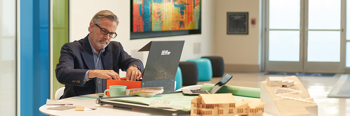 A large image of an architect seated looking at some colors from the BEHR Architectural Color Box