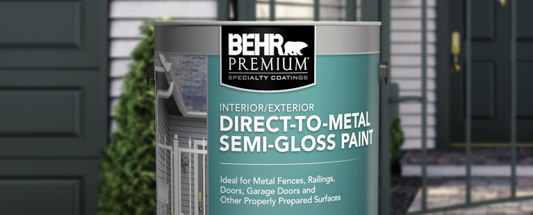Image of a 1 gallon BEHR PREMIUM Direct to Metal Semi Gloss Paint in the forefront of a metal railing.