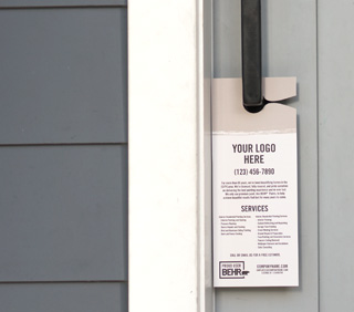 An image of door hanger that is hooked on a front door handle. The door hanger is printed with the words YOUR LOGO HERE - (123) 456-7890 - company.com - PROUD USER BEHR. Along with words you cant read but meant for businesses to put inro and list of services offered.