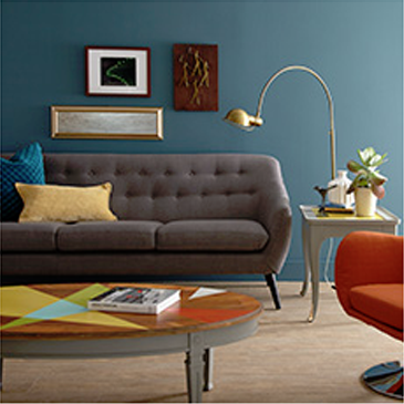 Living room with dark gray couch, orange chair, and coffee table