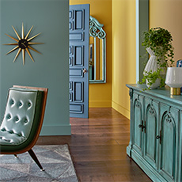 House entry area with green leather chair and matching dresser