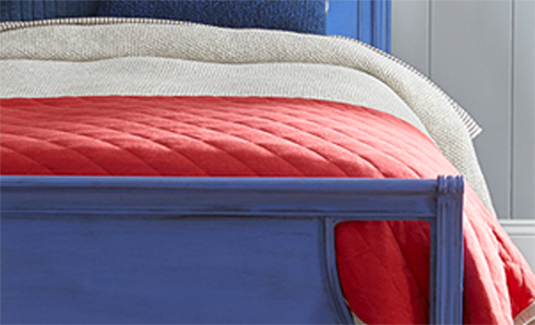 Bed with blue frame and red comforter