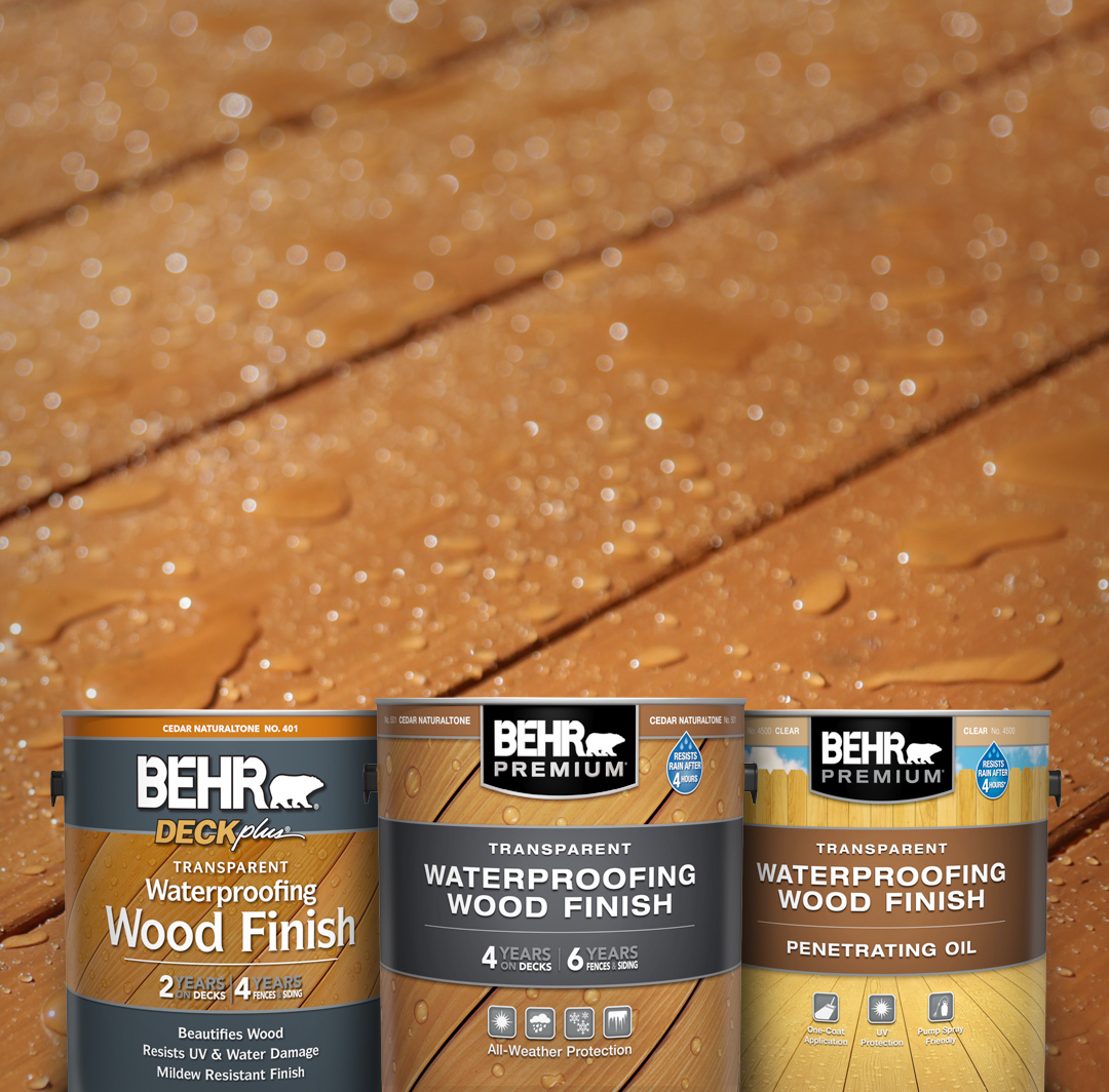 Mobile version of 3 Behr Transparent Stains against a wood deck.