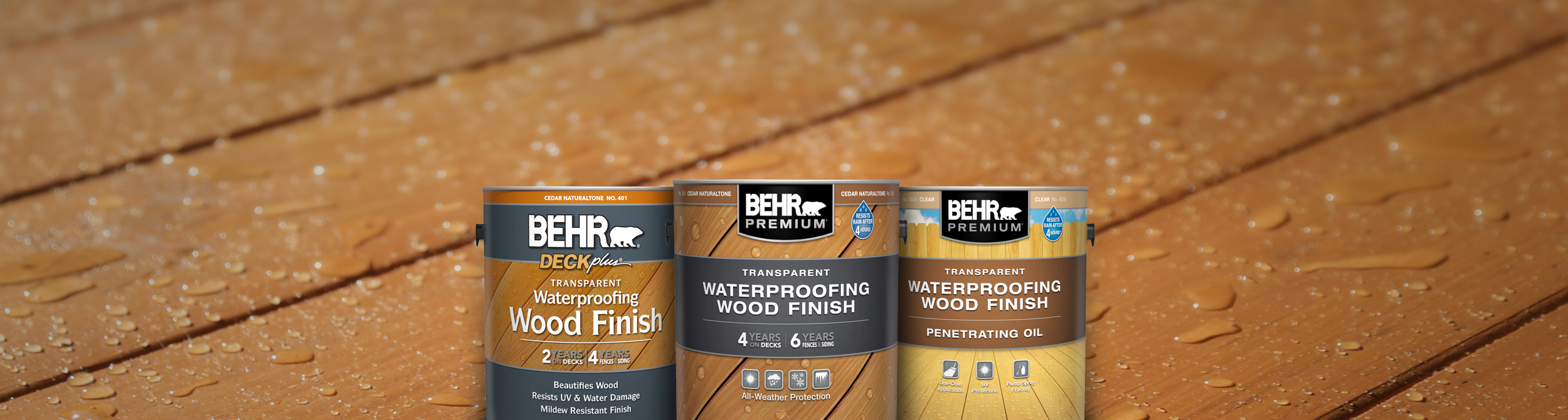 3 Behr Transparent Stains against a wood deck.