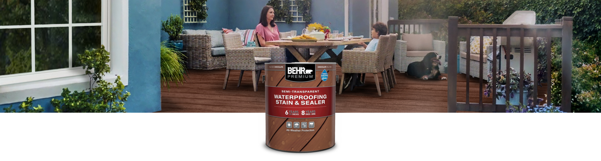 One can of Behr semi-transparent stain with a woman and son sitting outside on a wooden deck at a table in the background