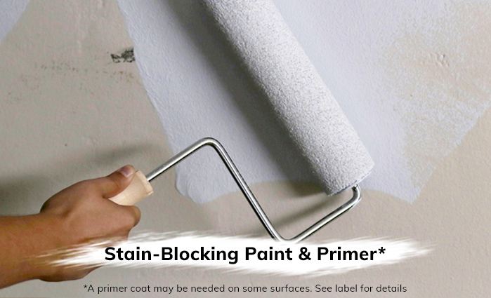 Rolling paint onto wall, covering stain marks