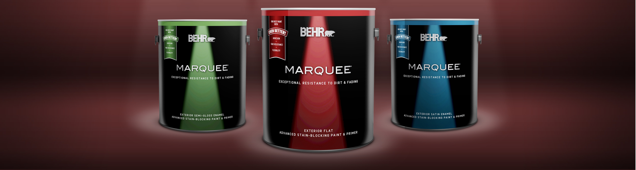 Three cans of Behr paint with maroon colored background