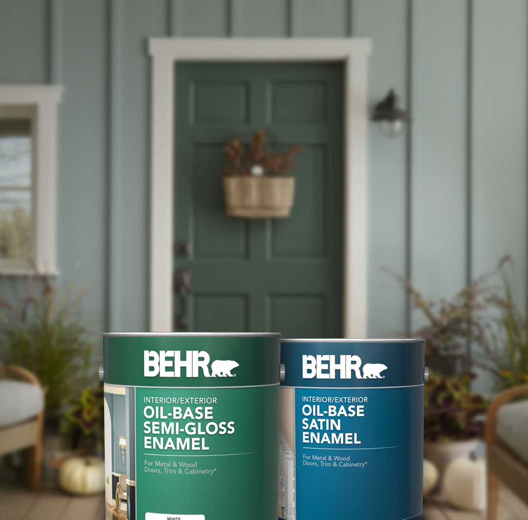 Mobile verision of 2 cans of Behr Oil Based Specialty Pant in front of door.