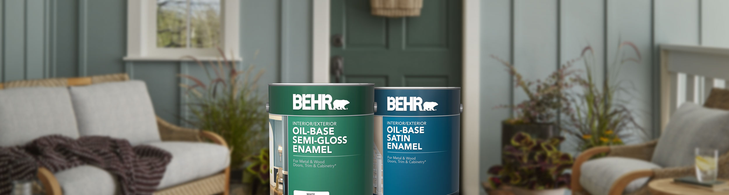 2 cans of Behr Oil Based Specialty Pant in front of door.