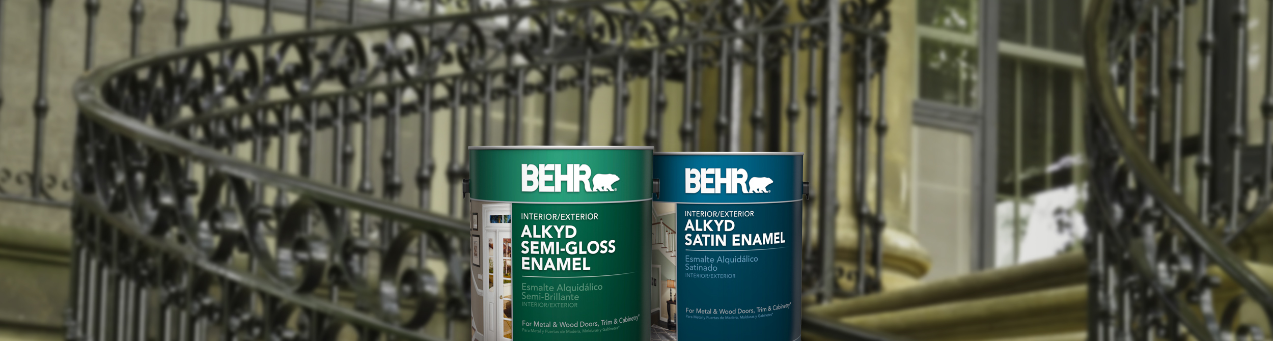 Two cans of Behr paint with metal railed stairs in the background