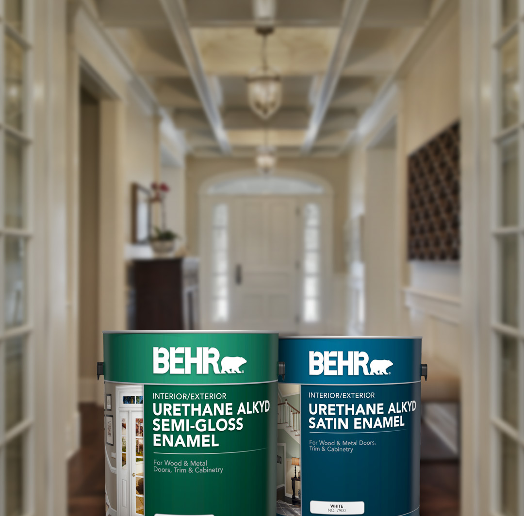 Two cans of Behr paint with hallway in the background