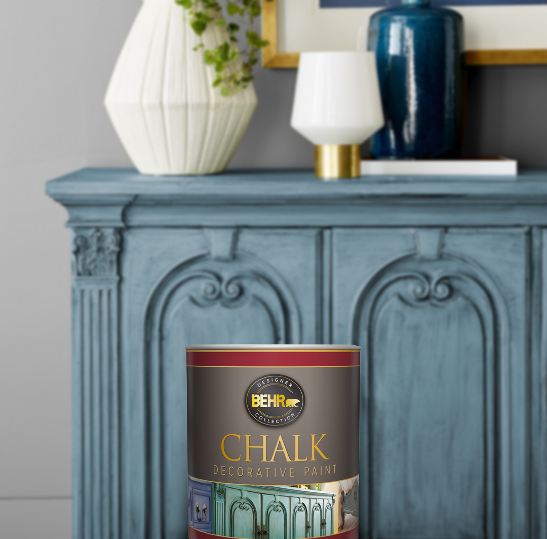 Can of Behr paint sitting in front of a blue cabinet
