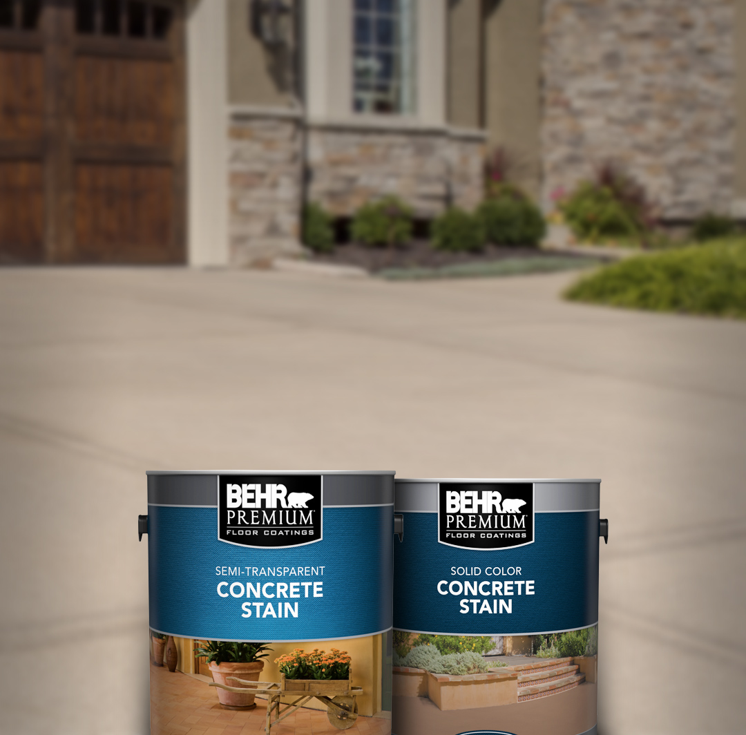 Two cans of Behr paint with brick house and driveway in the background. For mobile.