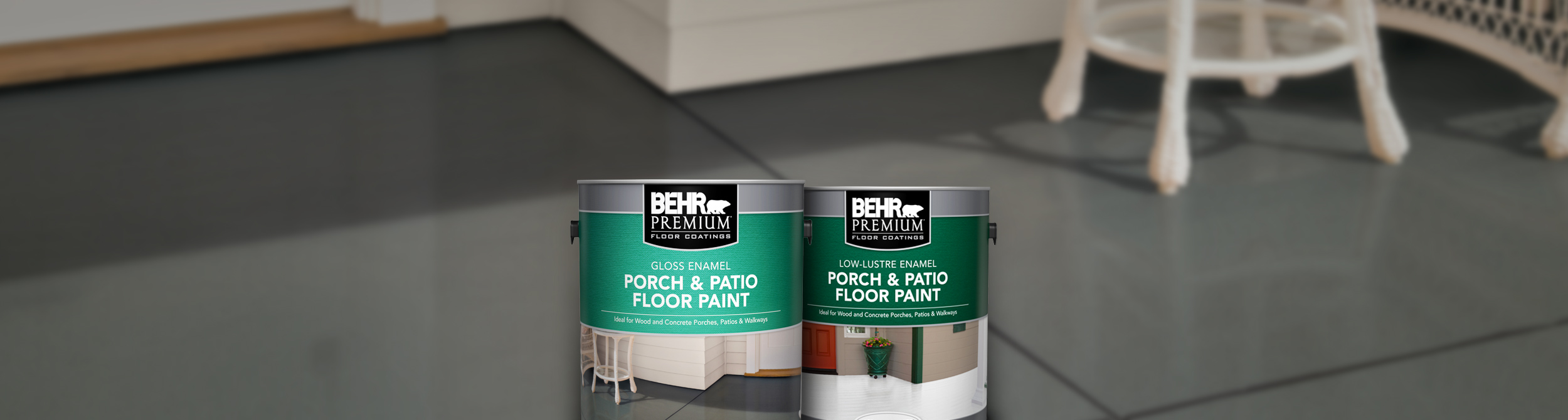 Two cans of Behr paint with porch floor in the background