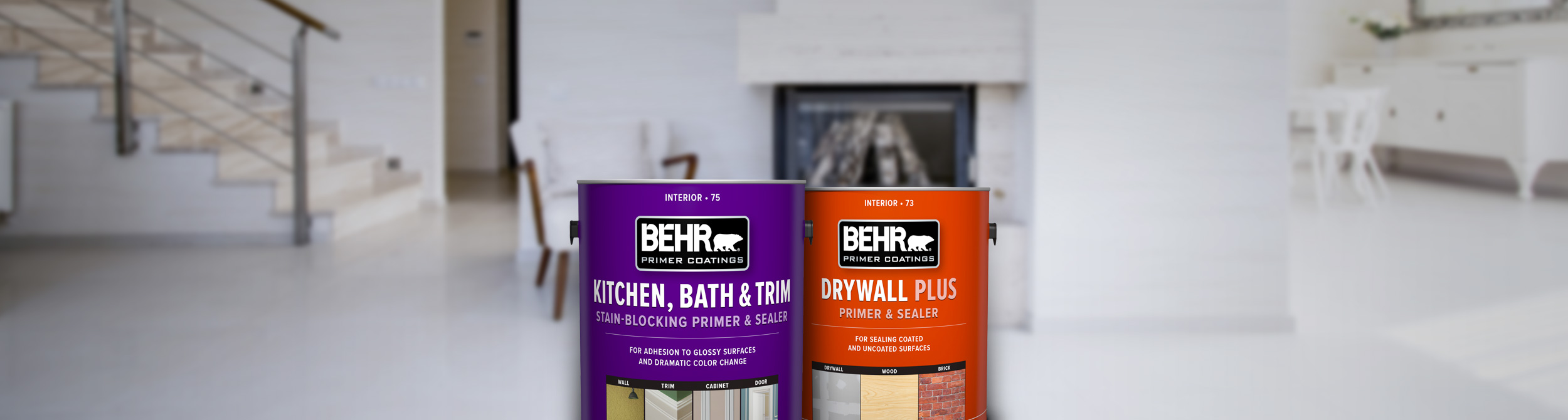 Two cans of Behr paint with white room in the background