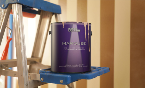 1 gallon can of Marquee Interior Paint sitting on a ladder