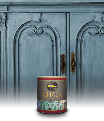 Can of Behr Chalk Decorative Paint with blue painted dresser in the background