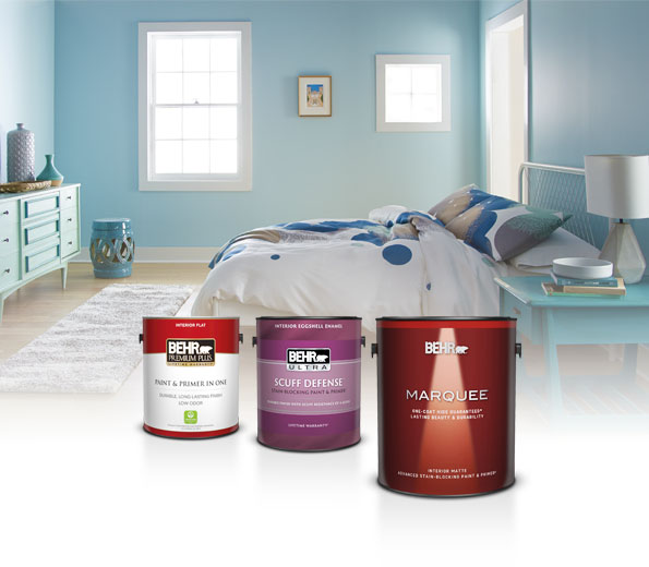 1 gallon cans of Premium Plus Interior Flat, Behr Ultra Scuff Defense Interior Eggshell and Marquee Interior Matte paints with a casual blue bedroom in the background