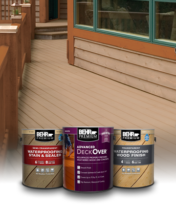 Beauty shot of deck with 1 gallon cans of Behr Premium Semi Transparent, Transparent and DeckOver products.