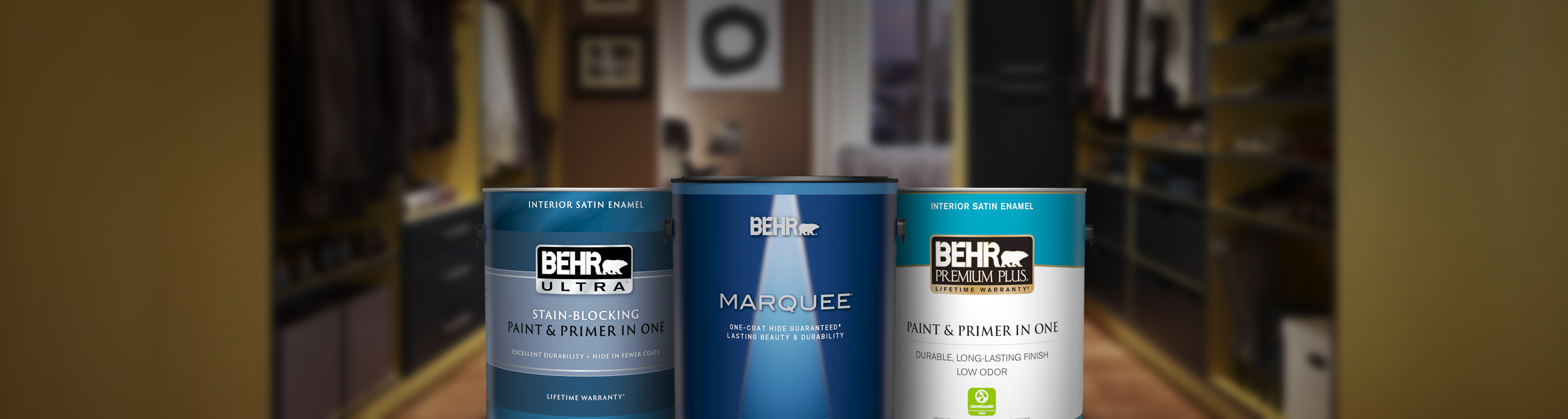 Three cans of Behr interior paint with closet and bedroom in the background