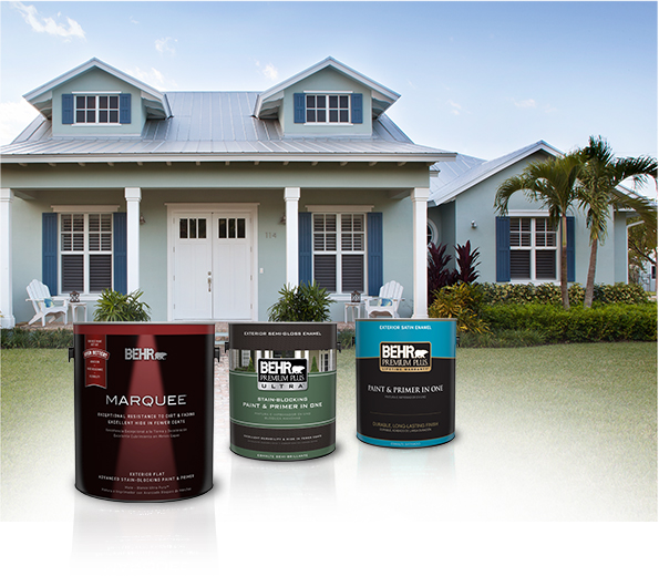 Three cans of Behr paint with blue house and palm trees in the background