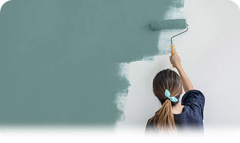 Promo tile featuring a woman painting a wall with a paint roller