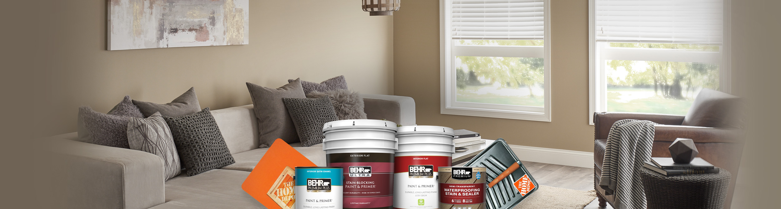 Montage of Behr Paint and Stain cans with a living room in the background