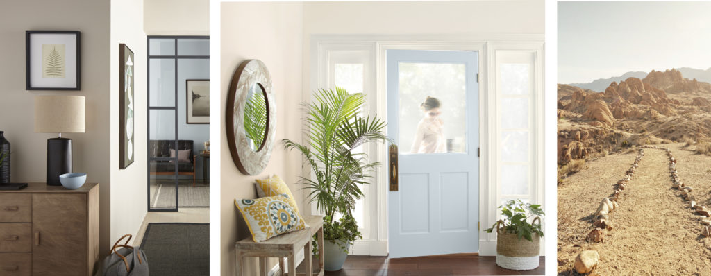 A hallway showing a peak of a iving room and an entry way. Both rooms the walls are painted in a light, almost white neutral color.