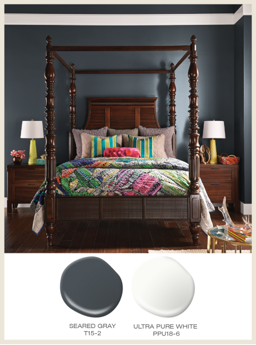 A global style bedroom featuring dark wood furniture.