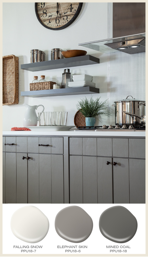 A farmhouse style kitchen with gray cabinets.