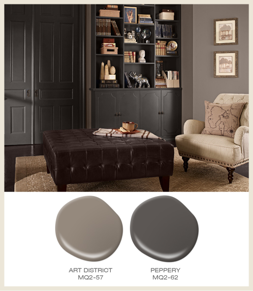 A gray tone-on-tone study featuring dark gray bookcase and double doors.