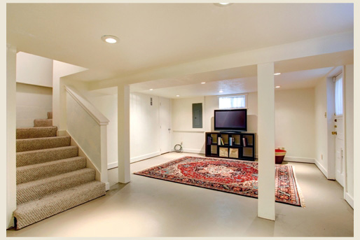 A simple basement and staircase with carpeted steps.